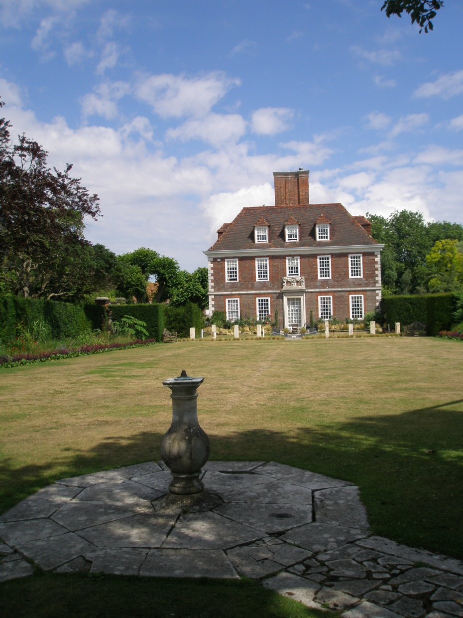 At one end of the Spring Garden, behind tall yew hedges, is the Bowling Lawn. which frames the best view of the House. This is the classic view of The Salutation.
