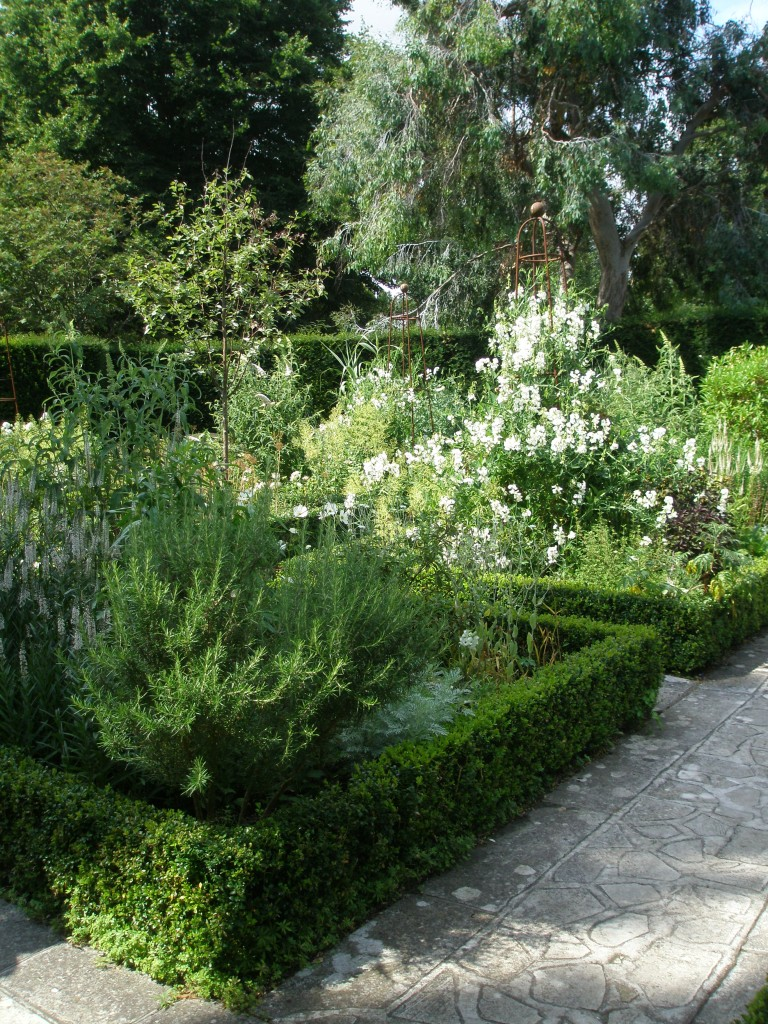 Shoe-horned into the most-pointed space on the property is the Circular White Garden