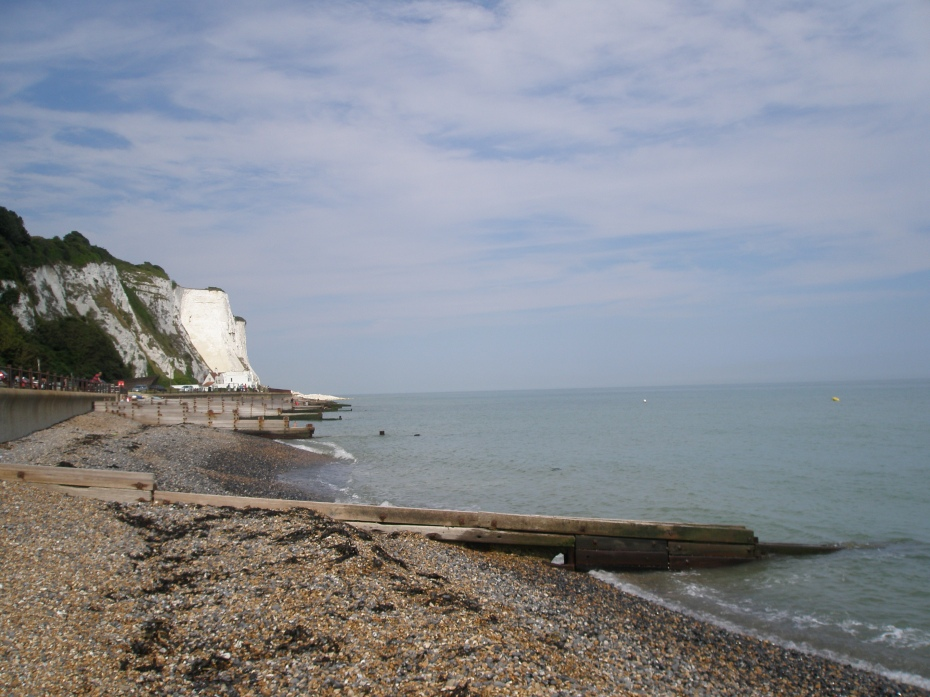 These wooden breakwaters are called GROYNES, and are built to control erosion of the shingle beach.