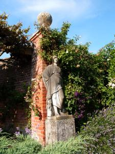 A more modestly-attired Lady stands guard in the Italian Garden
