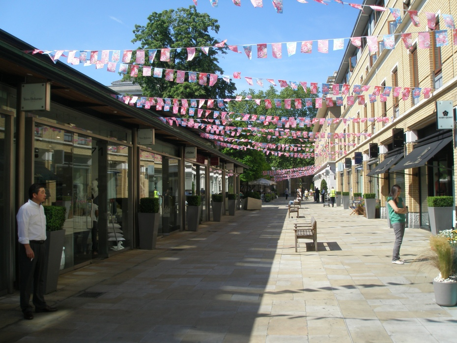 On Duke of York Square, flags announce the Chelsea in Bloom storefronts