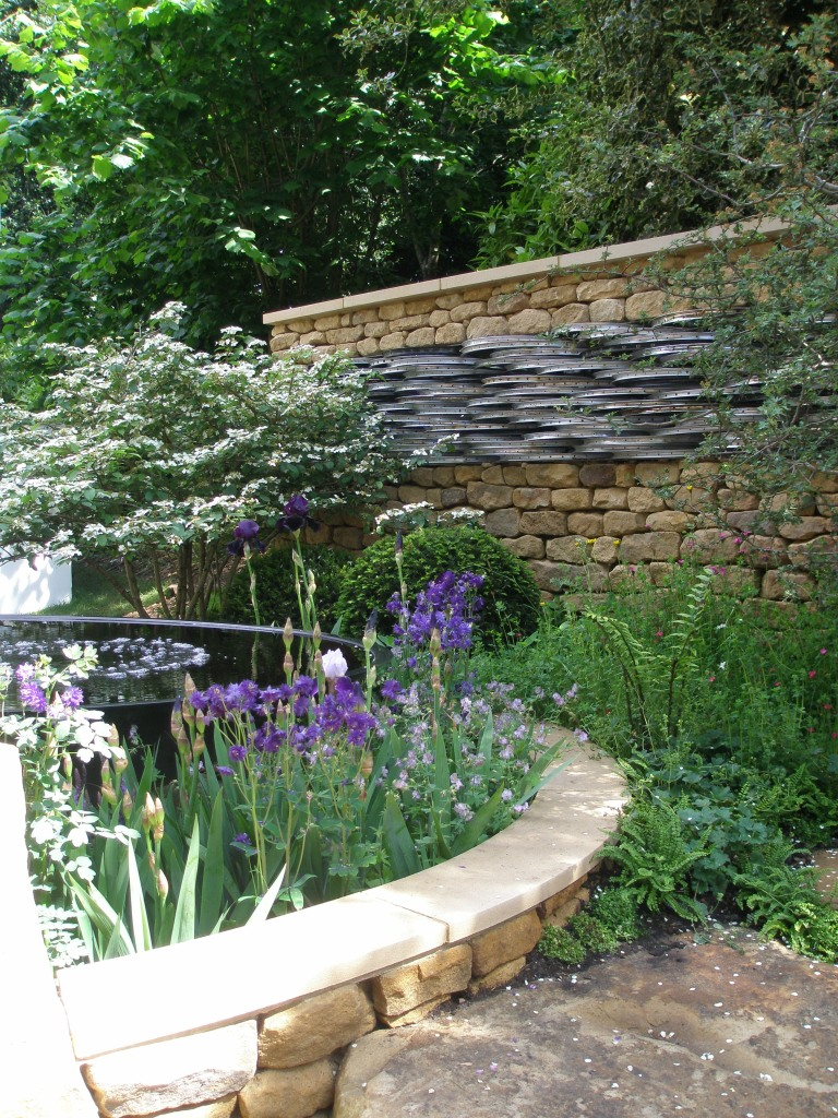 Tour de Yorkshire. The rear wall of this garden is partially composed of reclaimed bicycle wheels, sourced from recycling centers in Yorkshire.