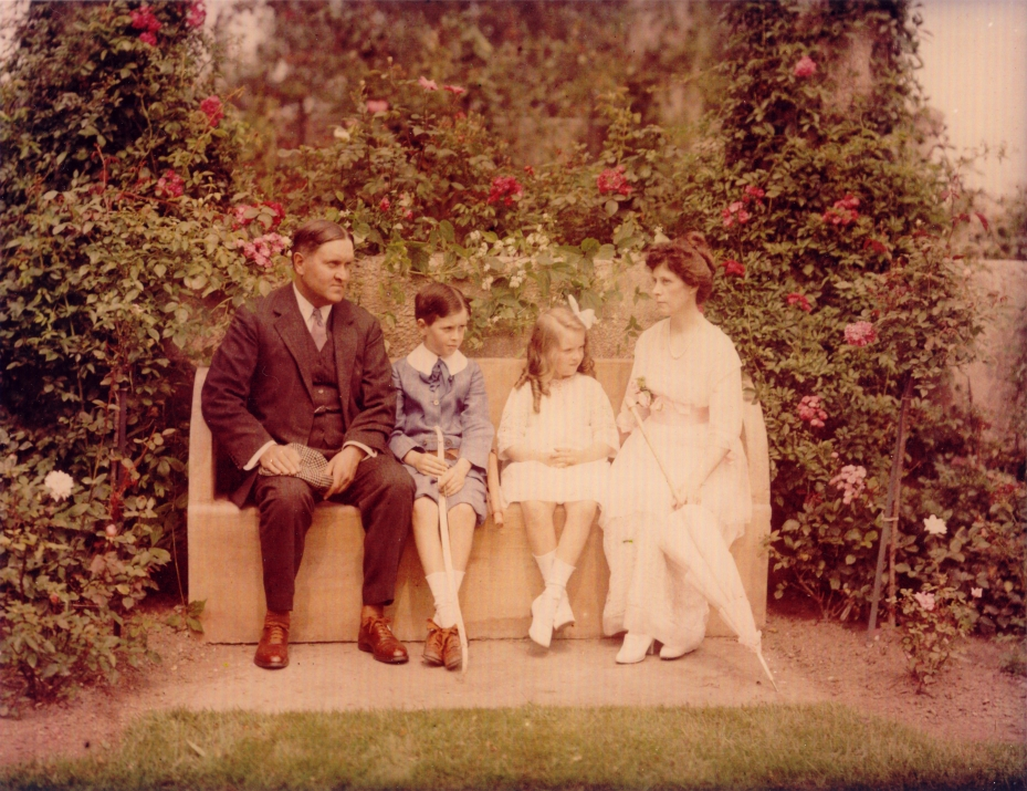 Hand-colored, vintage photo of the Crane family in their Rose Garden, circa 1915. Left to right: Richard Teller Crane Junior, Cornelius Crane, Miss Florence Crane, Mrs. Florence H. Crane. Image courtesy of the Trustees of Reservations, Archives & Research Center