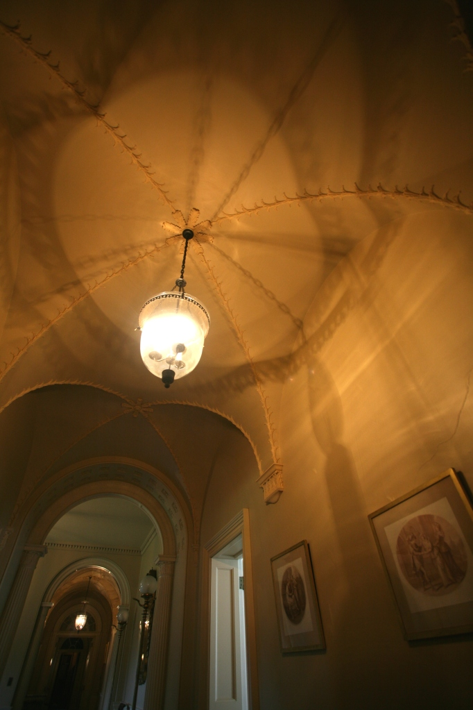 Mesmerizing shadows play upon the vaulted ceiling of the second floor halllway