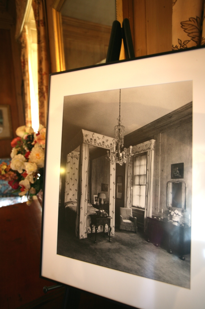 This vintage photo of Mrs. Crane's bedroom, as it appeared from 1928 until 1949, is displayed on an easel.