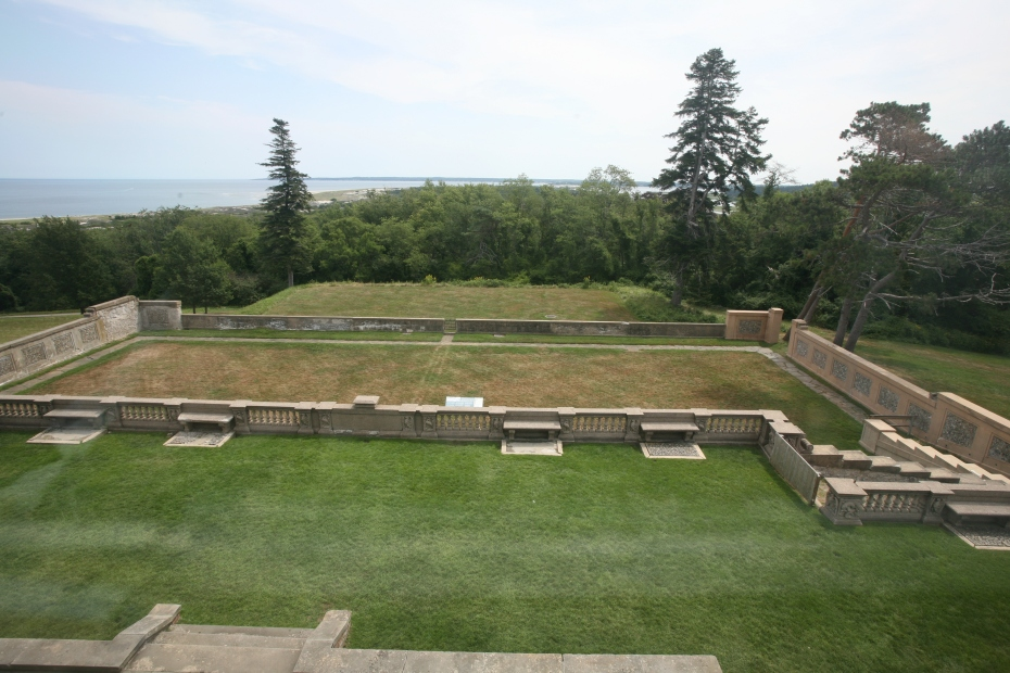 This is the view from the private sitting room, out to the east lawn. Below the lawn is the former site of a bowling green. And, on a still-lower terrace, an extensive hedge-maze was once planted. In the distance is beautiful Crane Beach, where I spent quite a few happy childhood weekends, getting sunburned.