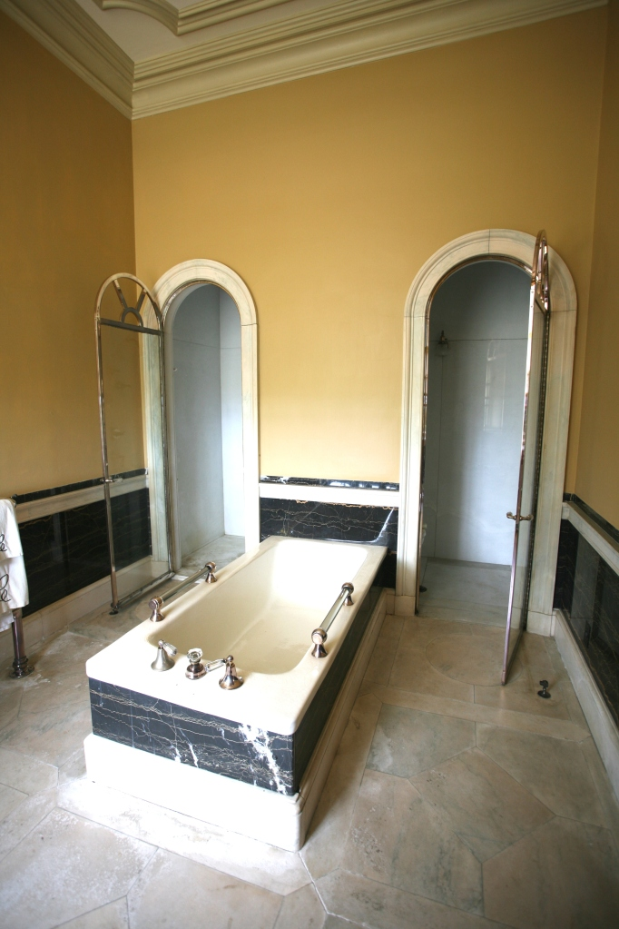 Mr. Crane's bathroom. Shower stall is to the left of the tub, and a toilet cubicle is to the right.