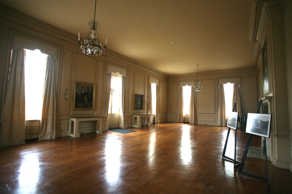 This was the Crane's Living Room, and is today used as a Ballroom. The Living Room has windows on three sides: facing south, east, and north. French doors on the east wall lead to a terrace overlooking a lawn, which was once a grass tennis court, and later, a bowling green. Below the bowling green was an arbor, and then, on a still-lower terrace, a hedge maze.