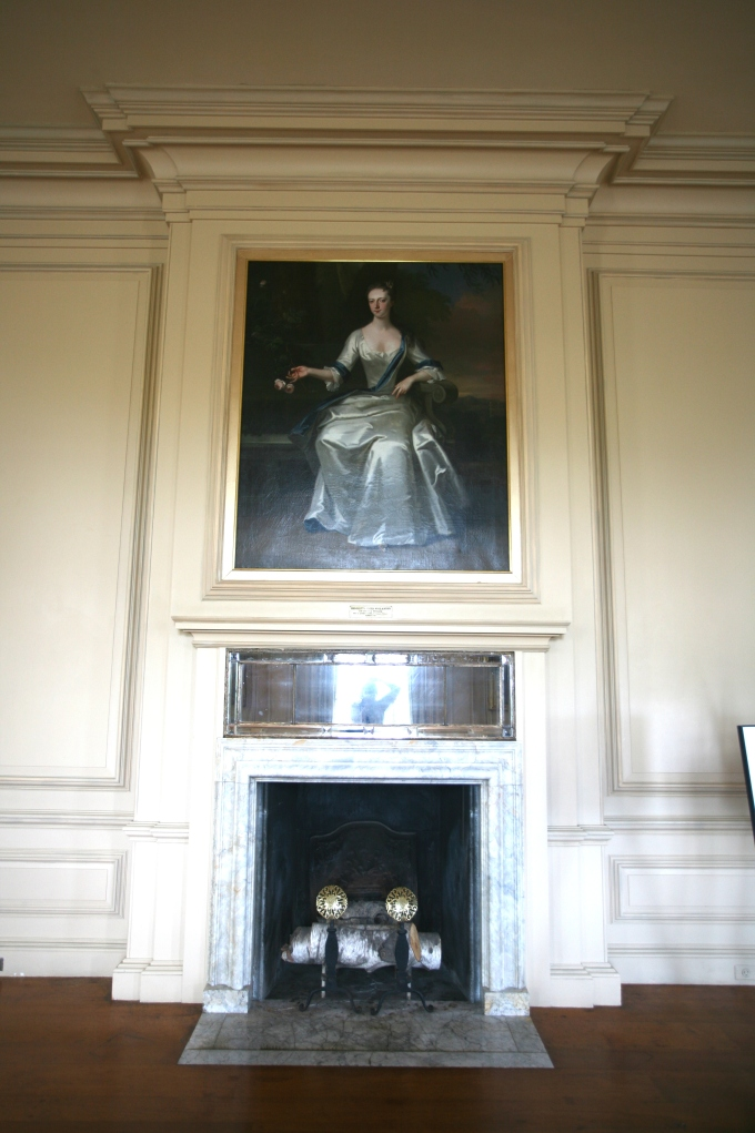 "The Living Room's fireplace. Per the Trustees, after Mrs.Crane's death in 1949, the entire contents of the Great House ""were sold at auction by Parke-Bernet, held on-site over the course of three days."" As the Trustees now restore the interiors at the Crane Estate, paintings and furnishings which resemble the originals used by the Cranes are being installed."