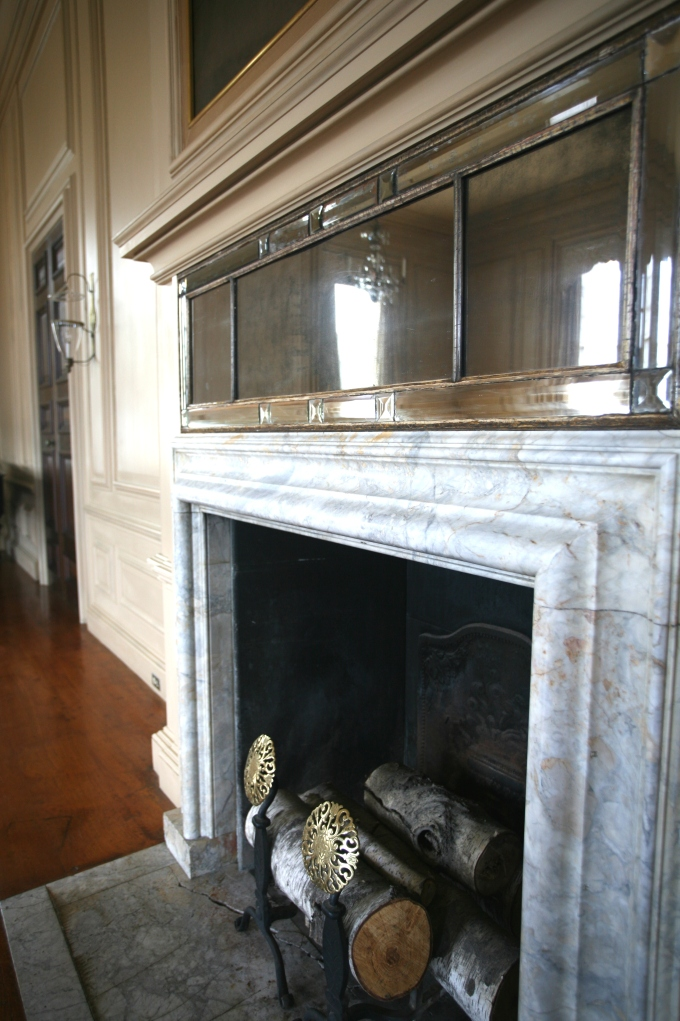 Detail of fireplace surround, in the Living Room. Happily, during the Parke-Bernet auction, only the family's furnishing and works of art were sold.  Many decorative features affixed to the walls have remained intact.