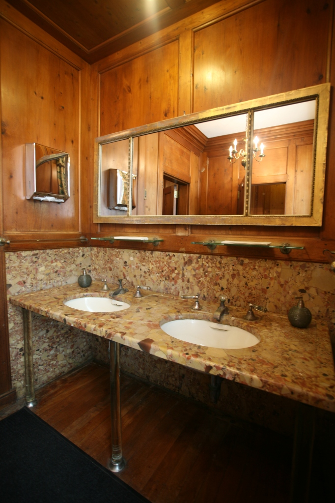 This area, to the right of the Reception Foyer, is now the Ladies Bathroom. When the Cranes lived here, these rooms served as the mens' dressing room. The walls are paneled with English deal (which is a soft wood similar to pine).