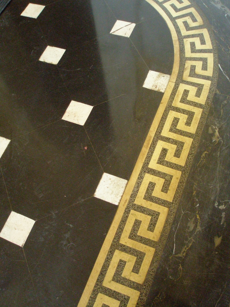 Detail of Foyer floor: black and white marble, inlaid with a brass Greek key design.