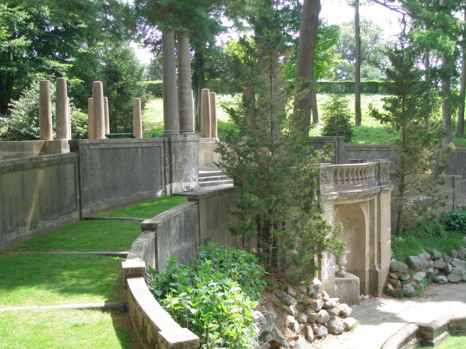 From both sides of the balcony, grass ramps curve down around the now-dry Pool and Grotto.