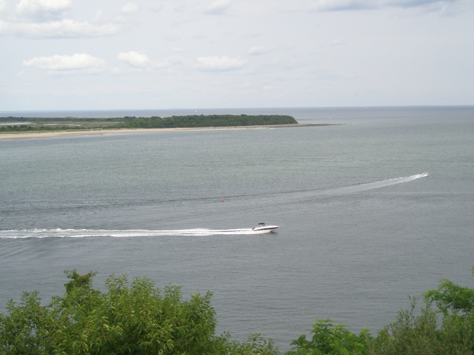 Motorboats zip across the Bay, toward the Atlantic.