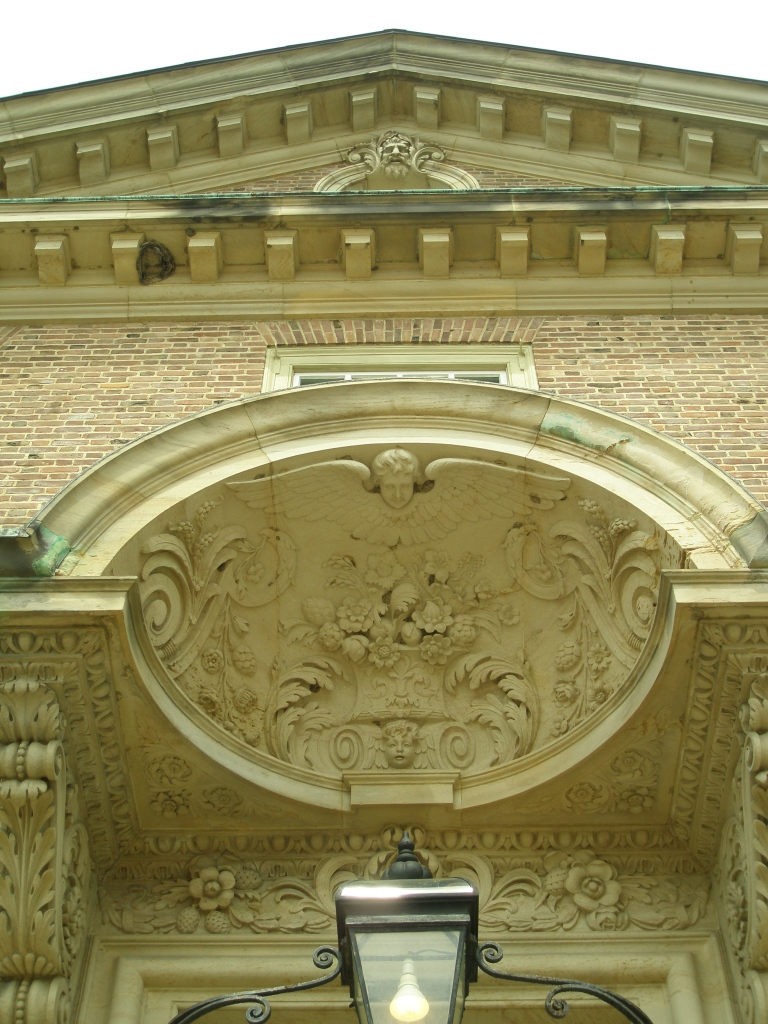 Carved canopy, over the front door