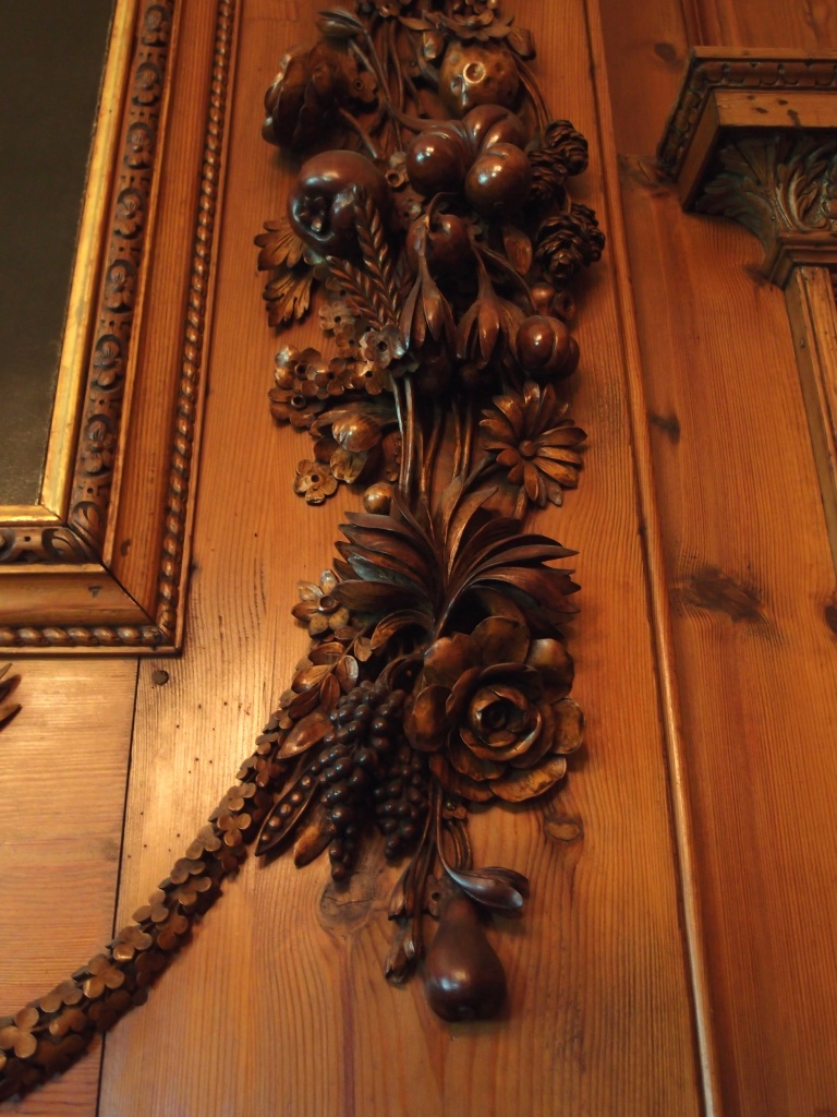 Gibbons' carving, to the side of Lady Anderton's portrait.