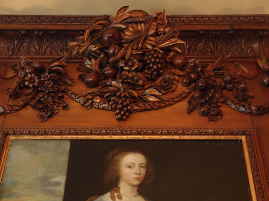 Grinling Gibbons' carvings crown---and rather outshine---a portrait of Lady Emma Anderton (which is actually OK, since Emma was simply a purchased portrait, and not a relative of the Crane family). This just goes to show, however, that even a beautiful lady cannot complete with Gibbons' artistry.