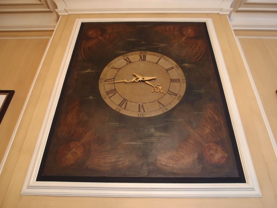 Detail of The Gallery's Clock. Chicago artist Abram Poole painted the four winds which encircle the clock.