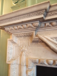 Detail of marble fireplace surround in Dining Room