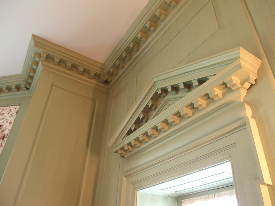 "Detail of Dining Room, with boldly dentated moldings, and a closer look at the paint color and glaze work. Per the Trustees: ""Careful paint analysis performed in 1997 revealed the monochromatic blueish-green base with a darker green glaze work. Further analysis in 2008 revealed a touch of blue to the light ceiling. The room was glazed from top to bottom in 2009 by Phyllis Tracy or Marblehead, MA."""