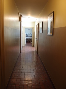 This corridor leads from the Butler's Suite toward a Flower Room (straight ahead), and also back to the Great House Stair Hall (door to the left).