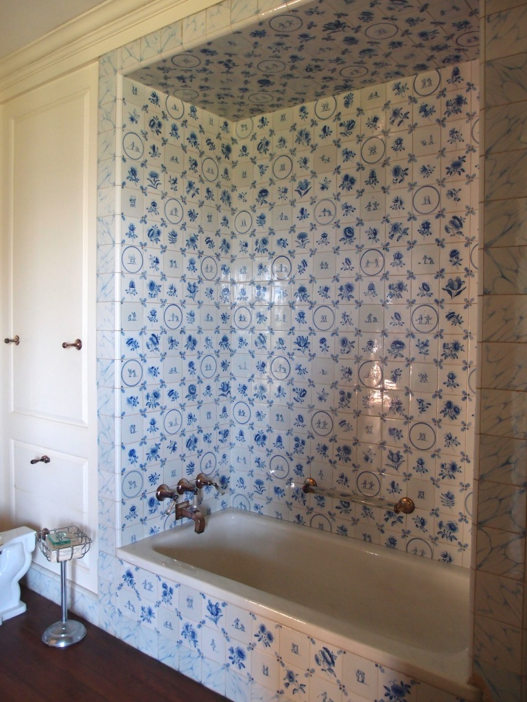 Cornelius' bathroom, with Delft tiles, and silver-plated fixtures, with Lucite accents.