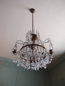 The delicate chandelier in Mrs. Crane's dressing room