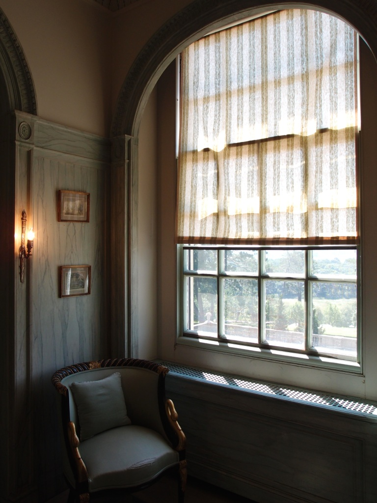 The large window in Mrs. Crane's bathroom has a view over the front entry court.