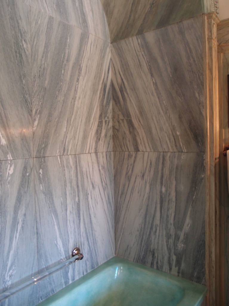 Detail of tub alcove: the marble pattern matching is done flawlessly