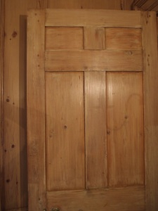 Detail of the very plain (but antique) door that separates Mrs. Crane's bedroom from the main second floor hallway.