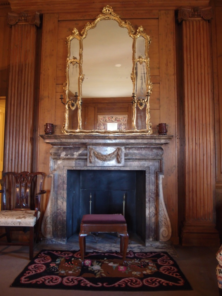 Fireplace in Mr. Crane's bedroom. Both the wall paneling, and the marble fireplace surround, came from the dismantled 18th century London townhouse.