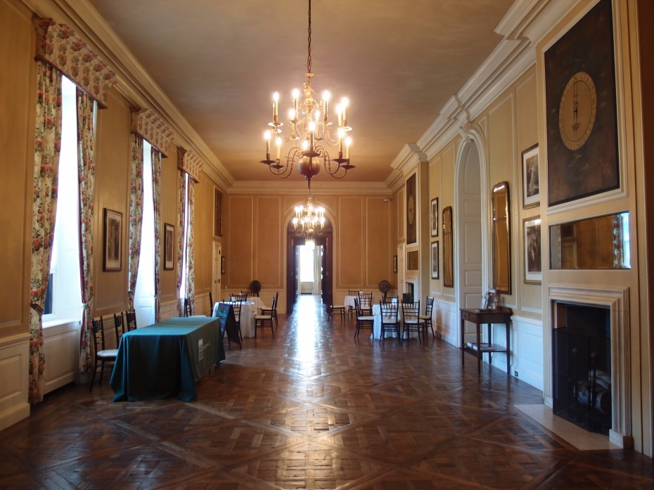 The Gallery connects the east and west wings of the Great House. This space is 63 feet long, with a 16-foot ceiling. A bank of windows in the Gallery overlooks the back terrace, and the half-mile-long Grand Allee, which extends to the Atlantic Ocean.