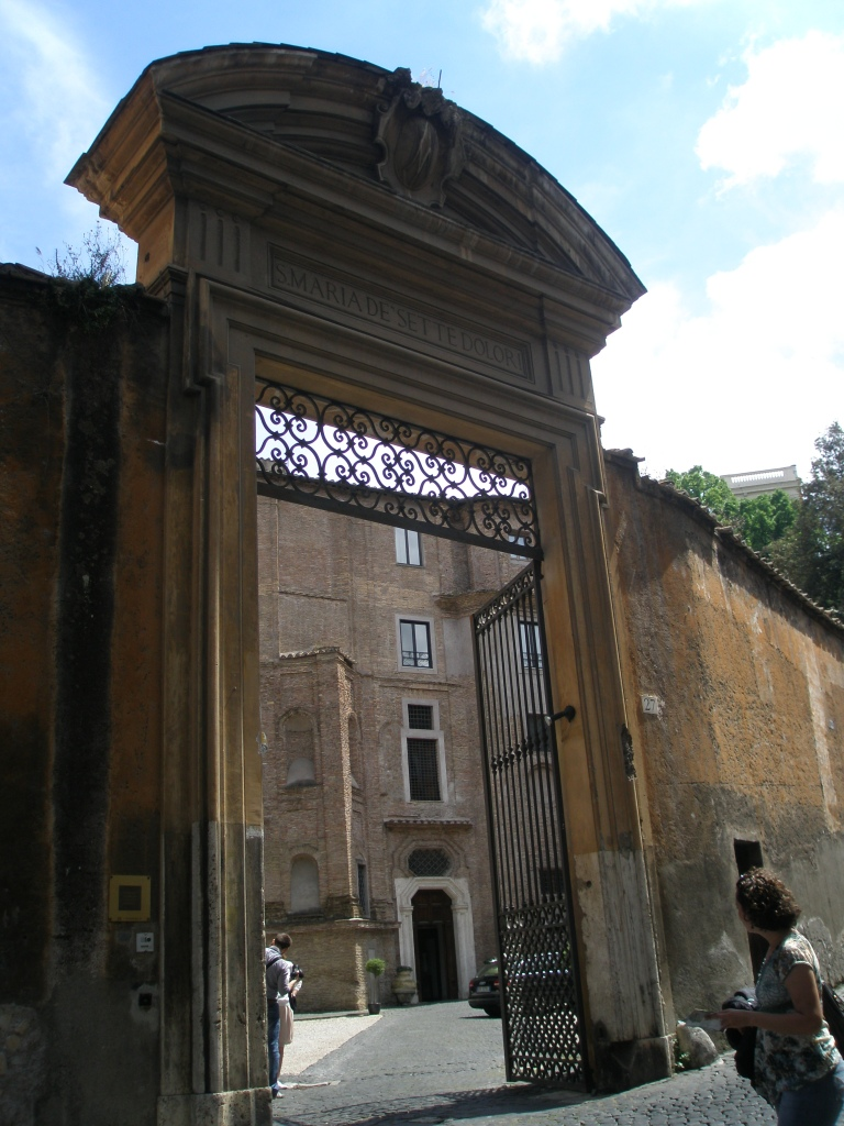 The imposing Entry Gate to the Donna Camilla Savelli Hotel's front courtyard, as seen from via Garibaldi.
