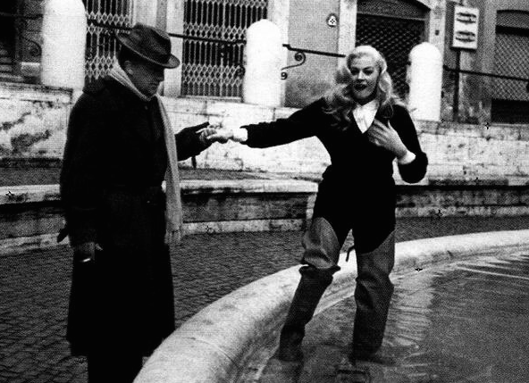 During rehearsals, Fellini helps his Star into the Trevi Fountain.