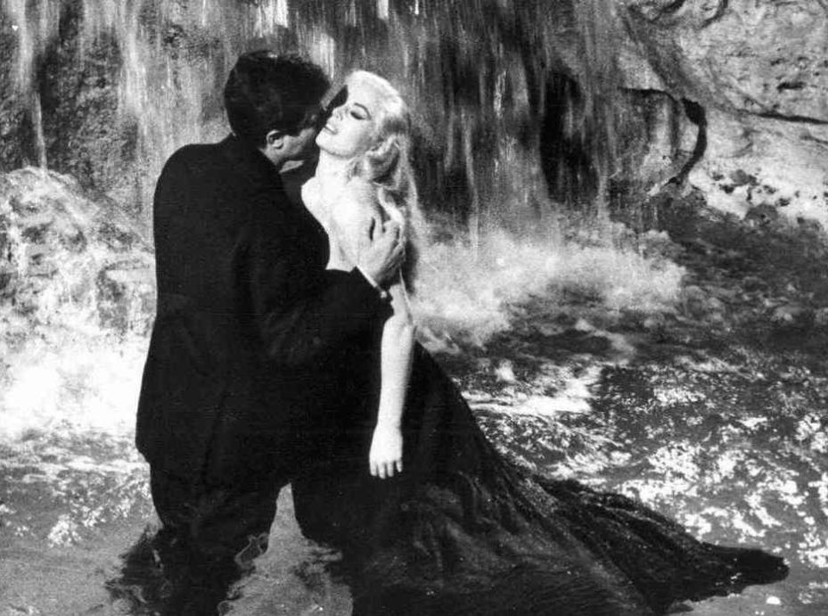 Marcello Mastroianni embraces Anita Eckberg in the Trevi Fountain scene from LA DOLCE VITA.