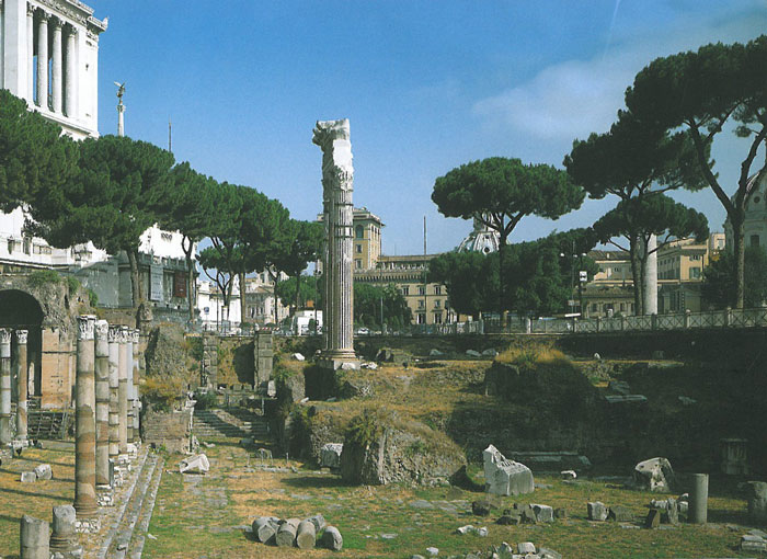 Seen from within the Roman Forum, this is today's view of the place where the Forum of Caesar once stood. To the left, a tiny portion of the hulking and always unavoidable Il Vittoriano, which was built in 1885. Image courtesy of ROME:PAST&PRESENT, by R.A.Staccioli.