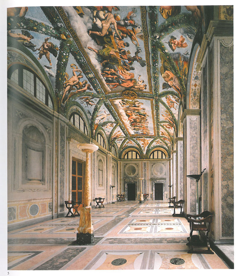 The Loggia of Cupid & Psyche. This enormous hall was the space through which the Villa was originally entered. The hall measures 60 feet long, by 21 feet deep, and has a ceiling height of about 25 feet. The frescoes were painted in 1518 by Raphael and his assistants. Image courtesy of LA VILLA FARNESINA A ROMA, published by Franco Cosimo Panini.