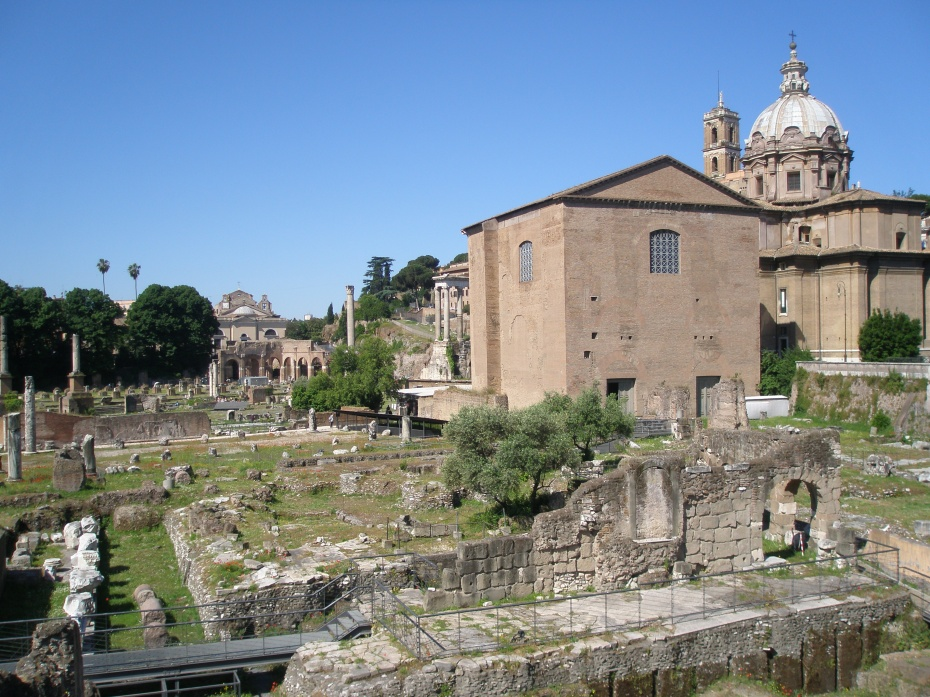 My view of the Curia (to the right) and the site of the Basilica Aemilia (to the left), as seen from the sidewalk along Via del Fori Imperiali.