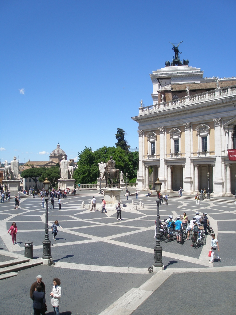 A clearer look at the intricate paving patterns of the Piazza, with the Palazzo Nuovo wing of the Capitoline Museum at the far edge of the Piazza.