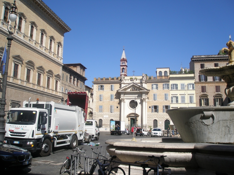 Piazza Farnese, as I saw it in June of 2011. This was one of those Tourist's-Reality-Check-Moments: Garbage Collection Day! Several odoriferous dumpsters were plopped around a giant TUB Fountain, which the Farnese had placed i the Piazza during the Renaissance.