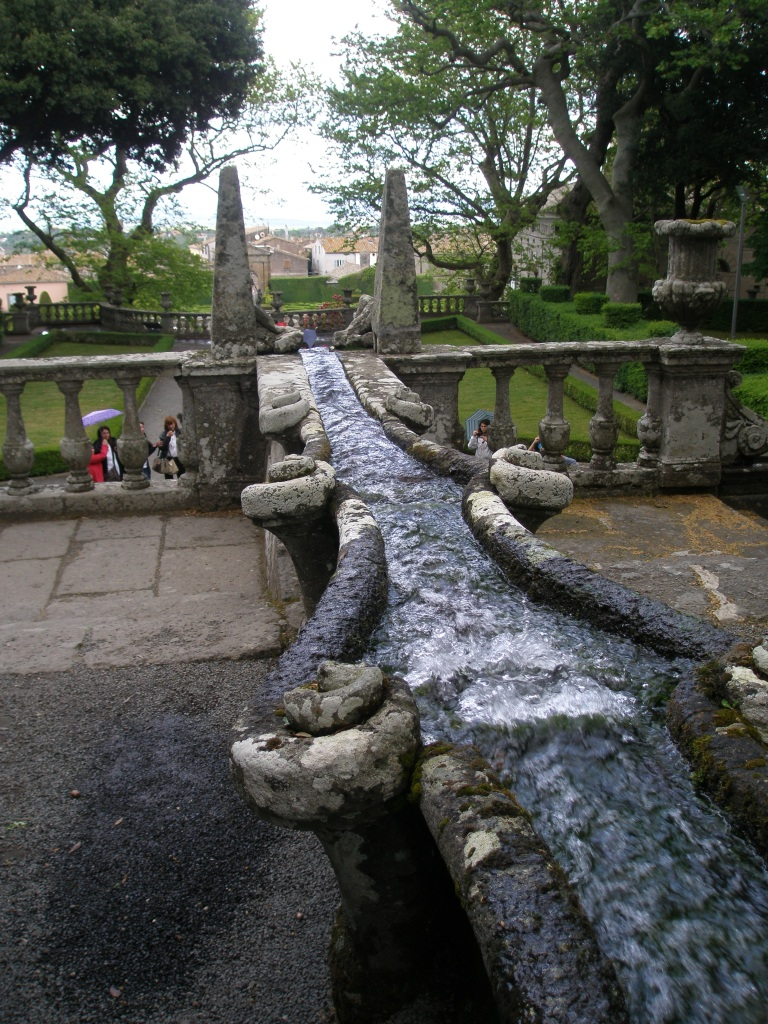 Two Obelisks mark the lowest point of the Water Chain. Directly below the balustrade is the Fountain of the Giants (or Rivers).