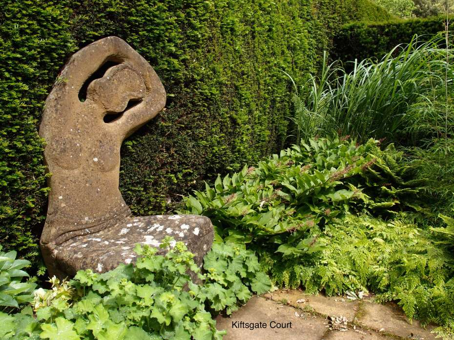 This Stone Lady serves as a chair, in a secret garden that's adjacent to the new, Water Garden.