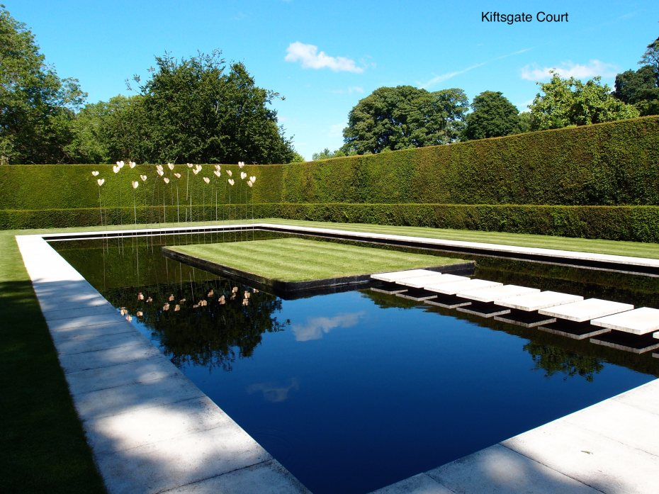 Another WOW moment, as I passed through an opening in a high, yew hedge and saw this. The Water Garden, added in 1998, replaces an old tennis court. The pool is surrounded by narrow, white paving stones which contrast with the black water. Stepping stones lead to a grassy island.