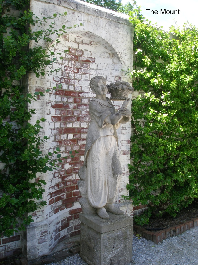 A Statue, circa 1901, in the walled Forecourt of the Main House