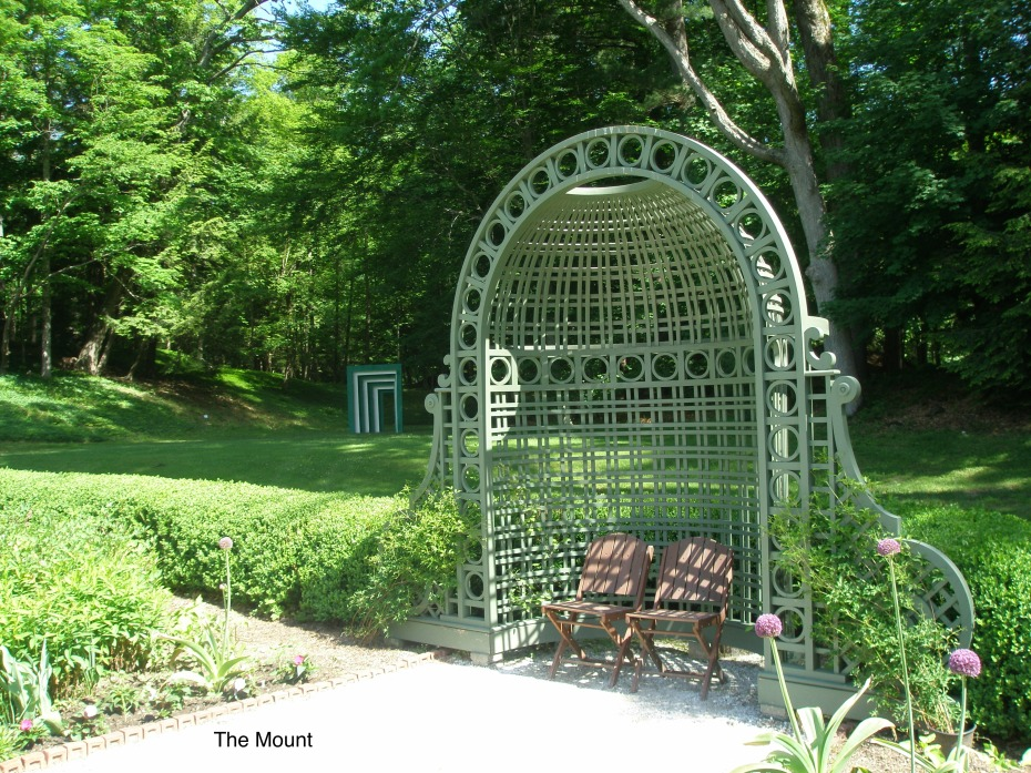 Here's a nice transition, from new to old. In the background: a contemporary, green and white archway. In the foreground: the Flower Garden's original Trellis Niche (designed by Ogden Codman Jr., when the house was built).