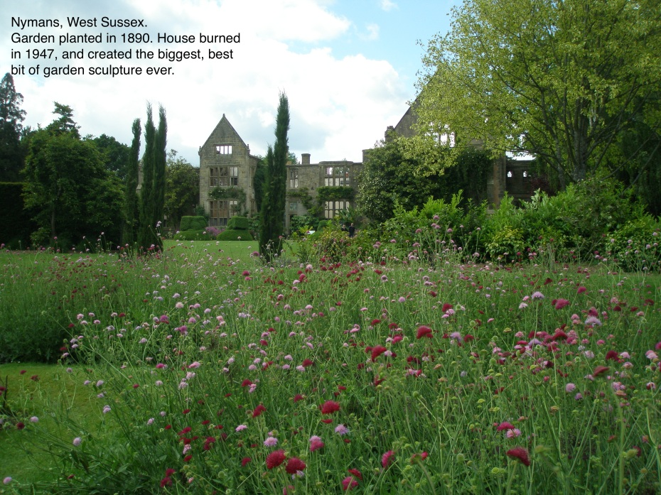 The Gardens at Nymans, with a view of the remains of the house.