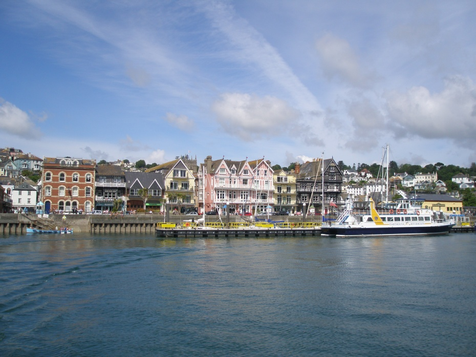 As our voyage upriver begins, we admire the Village of Dartmouth