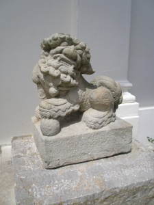 A pair of Foo Dogs stand guard on the front steps.