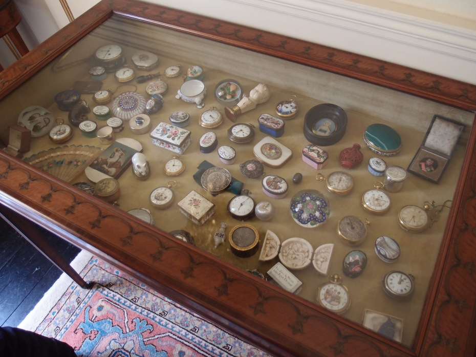 Display cabinet in the Front Hall. Before the property was opened to visitors in 2009, every item in the House was catalogued by The National Trust.