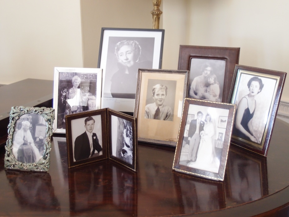 Family photos on display in the Drawing Room